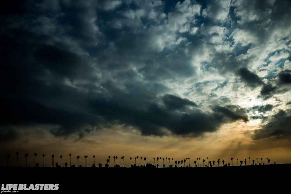 bohan california sunset clouds smog palm trees